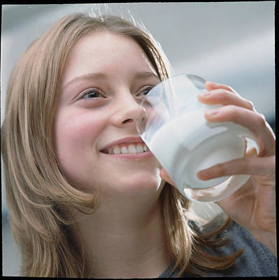 Teenage Girl Drinking A Glass Of Milk Poster by Damien Lovegrove