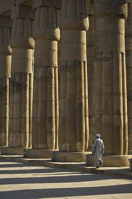 Temple Guard Walking Past Columns In Poster