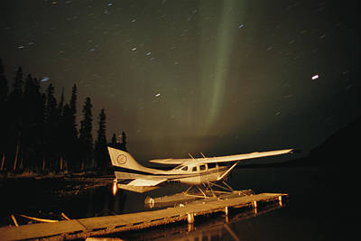 The Aurora Borealis Glows Brightly Poster by Raymond Gehman