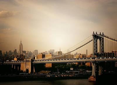 The New York City Skyline And Manhattan Bridge At Sunset Poster