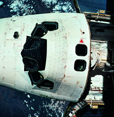 The Space Shuttle Orbiting Above The Earth Poster by Stockbyte