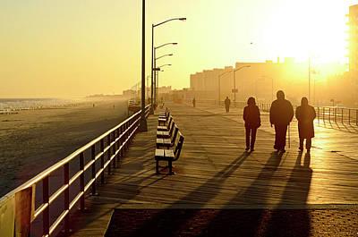 Three People Walking Down Boardwalk Poster