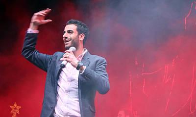 Tony Kattan Performing In Bethlehem Poster by Munir Alawi