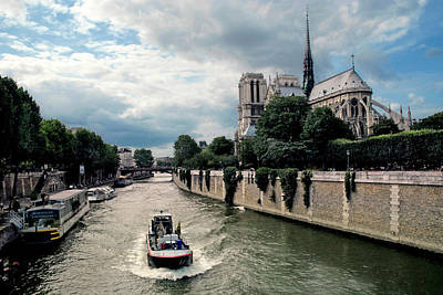Poster featuring the photograph Tour Boat Passing Notre Dame by Dave Mills