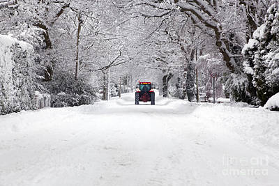 Tractor Driving Down A Snow Covered Road Poster
