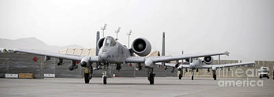 Two A-10 Thunderbolts Taxi Poster by Stocktrek Images