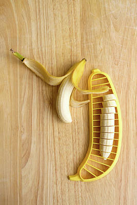 Two Bananas On Cutting Board Poster by Kelly Sillaste