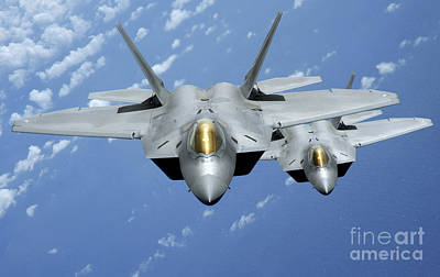 Two F-22 Raptors Fly Over The Pacific Poster by Stocktrek Images