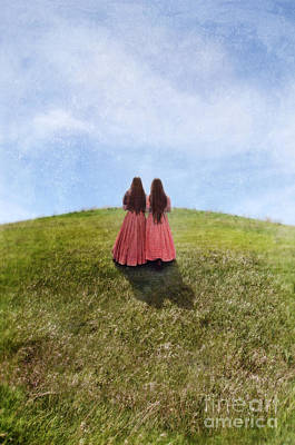 Two Girls In Vintage Dresses Walking Up Grassy Hill Poster by Jill Battaglia