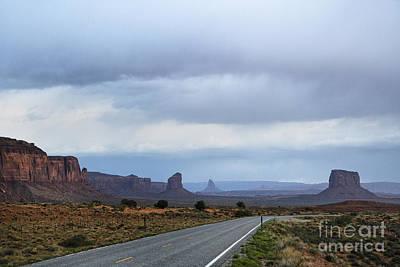 Two Lane Road Passing Through Desert Poster by Ned Frisk