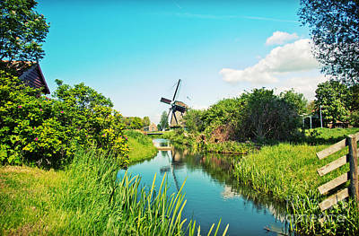 Poster featuring the photograph Typical Dutch  Windmill by Ariadna De Raadt