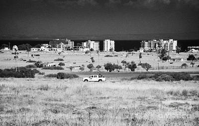 Un Border Patrol Driving Through The Heat Haze In The Un Buffer Zone In The Green Line Famagusta Poster