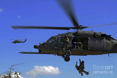 U.s. Air Force Pararescuemen Poster by Stocktrek Images