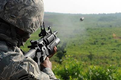 Us Soldier Fires A Practice Round Poster by Everett