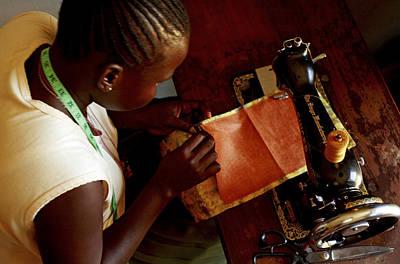 Using A Sewing Machine, Uganda Poster by Mauro Fermariello