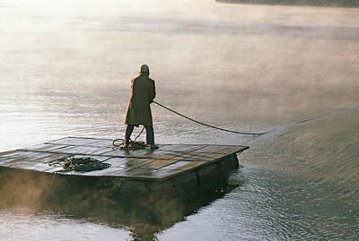Villager On Raft Crosses Lake Phewa Tal Poster