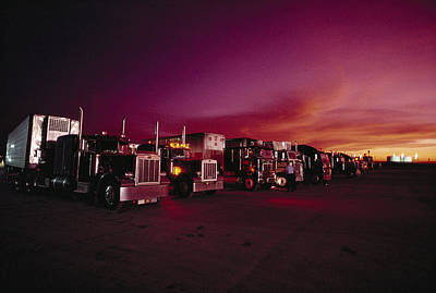 Vivid Sunset Over Trucks Parked Poster