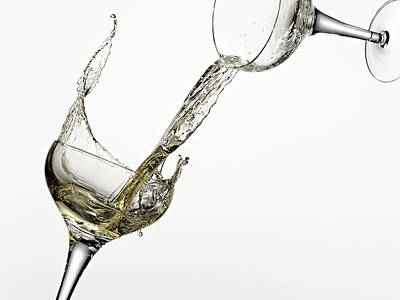 White Wine Pouring From One Glass Into Another Poster