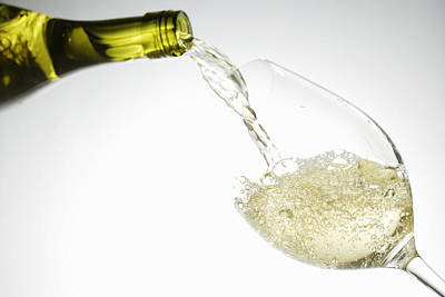 White Wine Pouring Into Glass Poster