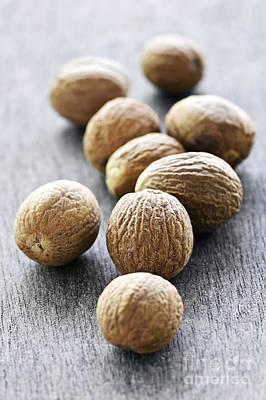 Whole Nutmeg Seeds Poster by Elena Elisseeva