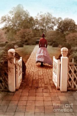 Woman In Vintage Clothing Walking Through Gate Poster by Jill Battaglia