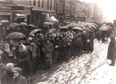 Women Walking Through Snow And Slush Poster