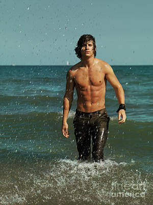 Young Man Walking Out Of The Water Poster
