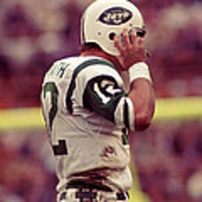 Joe Namath Fixing Helmet Poster by Retro Images Archive