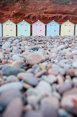 Beach Huts And Pebbles Poster