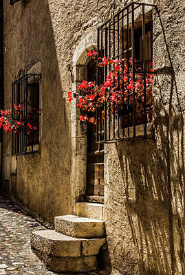 A Barred Window And Door With Red Begonia And Contrasty Shadows Saint Paul De Vence France Poster