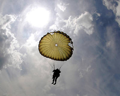 A Paratrooper Descends Through The Sky Poster by Stocktrek Images
