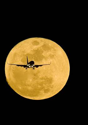 Aeroplane Silhouetted Against A Full Moon Poster by David Nunuk