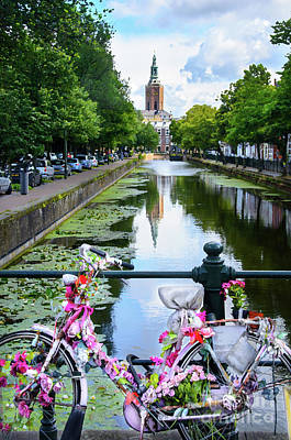 Poster featuring the digital art Canal And Decorated Bike In The Hague by RicardMN Photography