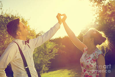 Couple In Love Making A Heart Shape With Their Hands In Sunshine Poster by Michal Bednarek
