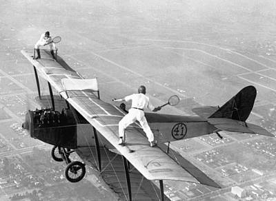 Daredevils Playing Tennis On A Biplane Poster