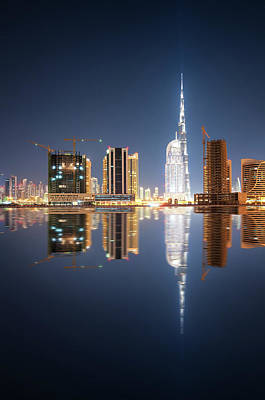 Fascinating Reflection Of Tallest Skyscrapers In Business Bay District During Calm Night. Dubai, United Arab Emirates. Poster