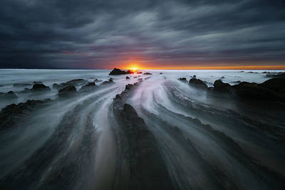 Flysch Rocks In Barrika Beach At Sunset Poster by Mikel Martinez de Osaba