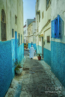 Man In White Djellaba Walking In Medina Of Rabat Poster