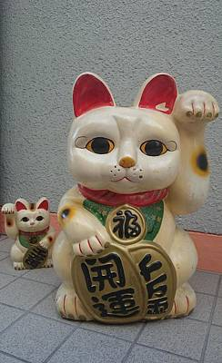 A Figure Of A Beckoning Cat, Called 'manekineko' Poster