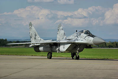 Poster featuring the photograph Mikoyan-gurevich Mig-29as by Tim Beach