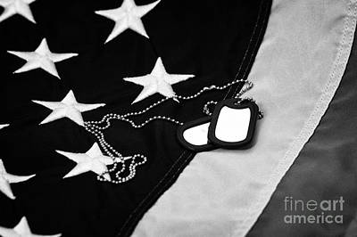 Military Dog Tags Lying On United States Of America Flag Poster
