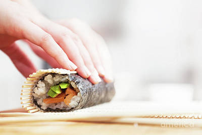 Preparing, Rolling Sushi. Salmon, Avocado, Rice And Chopsticks On Wooden Table Poster