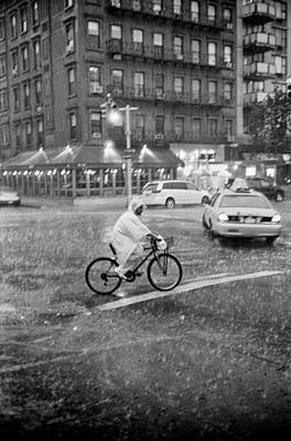 Poster featuring the photograph Rider In The Rain by Dave Beckerman