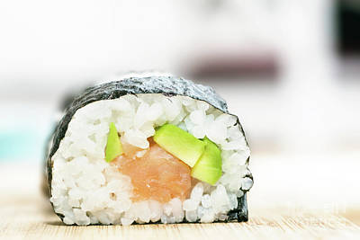 Sushi With Salmon, Avocado, Rice In Seaweed And Chopsticks On Wooden Table Poster