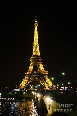 The Eiffel Tower At Night Illuminated, Paris, France. Poster by Perry Van Munster