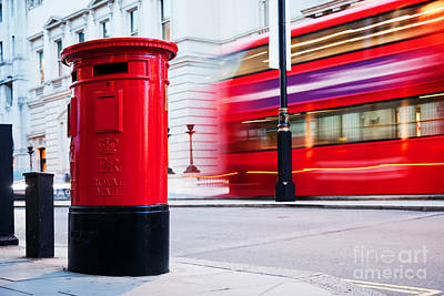 Traditional Red Mail Letter Box And Red Bus In Motion In London, The Uk Poster by Michal Bednarek