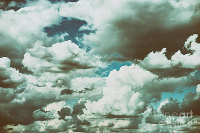 White Cumulus Clouds And Grey Storm Clouds Gathering On Blue Sky Poster