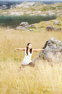 Yoga Poses In High Grass In Front Of A Mountain Lake In The Alps Poster