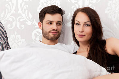 Young Couple Snuggling In Bed Poster by Wolfgang Steiner