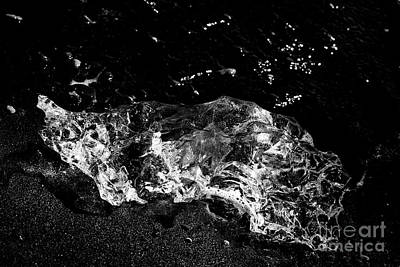 Ice Washed Up On Black Sand Beach At Jokulsarlon Iceland Poster by Joe Fox